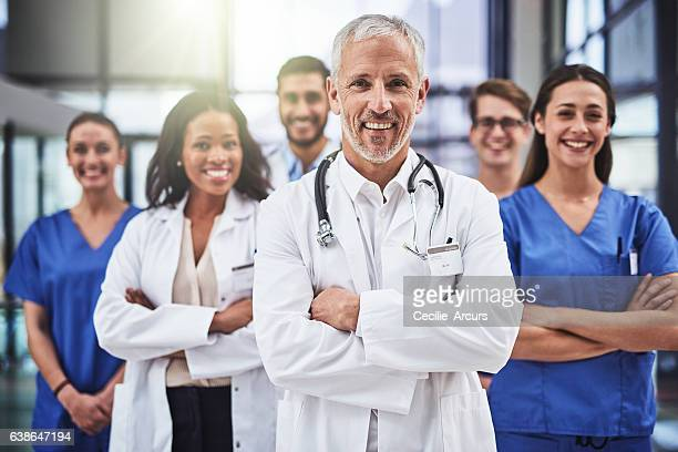 taking you from good health to great health - group of doctors stock pictures, royalty-free photos & images