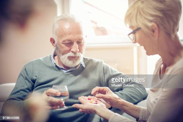 taking your pill. - taking a pill stock pictures, royalty-free photos & images
