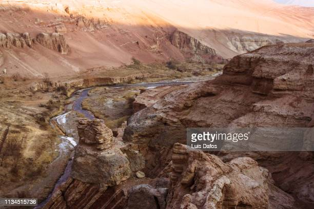 taklamakan desert, gorge in the flaming mountains - bedrock stock pictures, royalty-free photos & images