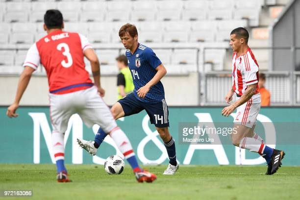 Taksahi Inui of Japan controls the ball against Paraguay defense during the international friendly match between Japan and Paraguay at Tivoli Stadion...