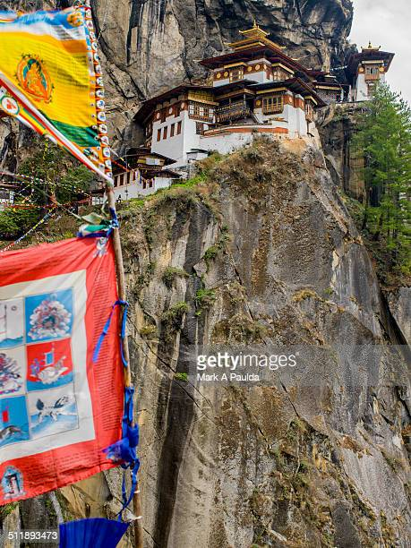 taktsang monastery and prayer flags - paro stock pictures, royalty-free photos & images