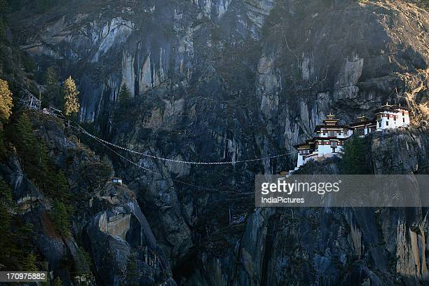 Taktsang Monastery is situated on a vertical cliff at 3000 meters altitude Bhutan