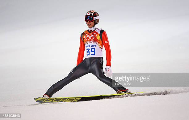 Taku Takeuchi of Japan lands his jump during the Men's Normal Hill Individual first round on day 2 of the Sochi 2014 Winter Olympics at the RusSki...