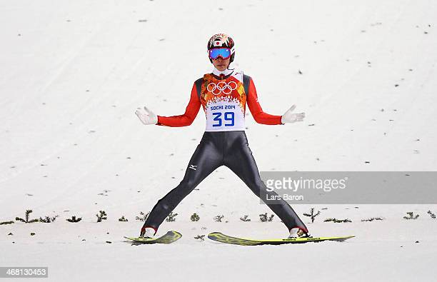 Taku Takeuchi of Japan lands his jump in the Men's Normal Hill Individual Final on day 2 of the Sochi 2014 Winter Olympics at the RusSki Gorki Ski...