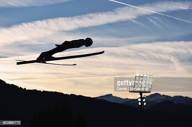Taku Takeuchi of Japan soars through the air during his competition jump on Day 2 of the 64th Four Hills Tournament event on December 29 2015 in...