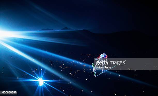 Taku Takeuchi of Japan soars through the air during his first competition jump on Day 2 of the 65th Four Hills Tournament ski jumping event on...