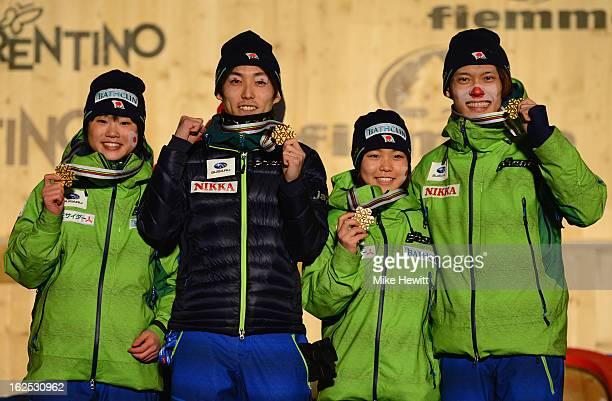 Taku Takeuchi Sara Takanashi Daiki Ito and Yuki Ito of Japan celebrate with their Gold medals at the medal ceremony for the Mixed Team Ski Jumping HS...
