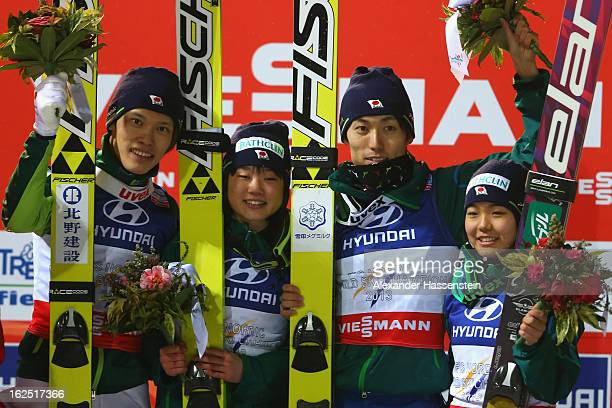 Taku Takeuchi Yuki Ito Daiki Ito and Sara Takanashi of Japan celebrate victory in the Mixed Team Ski Jumping HS 106 Final Round at the FIS Nordic...