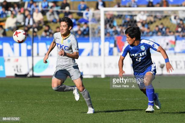 Taku Ushinohama of Tochigi SC takes on Masanobu Matsufuji of Azul Claro Numazu during the JLeague J3 match between Azul Claro Numazu and Tochigi SC...