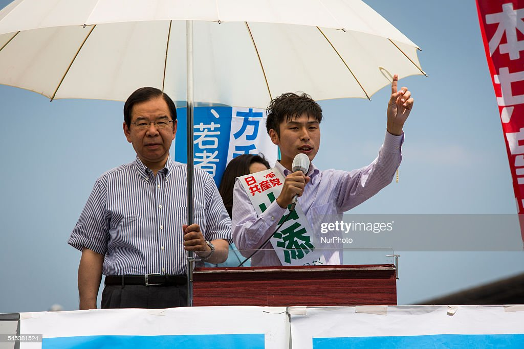 Taku Yamazoe, candidate from The Japanese Communist Party (JCP) delivers a campaign speech during the Upper House election campaign outside of Kichijji Station, Tokyo, Japan on July 7, 2016. Japan's upper house election will be held on this coming Sunday July 10, 2016.