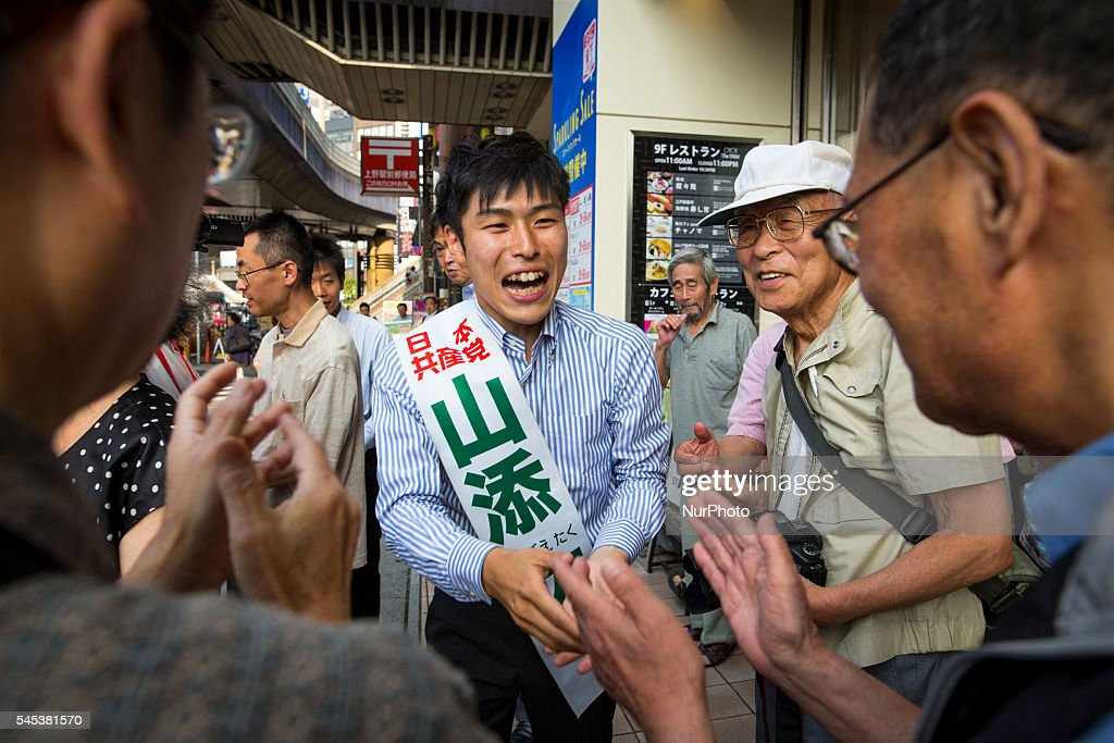 Taku Yamazoe, candidate from The Japanese Communist Party (JCP) greets supporters after his speech in Ueno, during the Upper House election campaign outside of Ueno Station, Tokyo, Japan on July 7, 2016. Japan's upper house election will be held on this coming Sunday July 10, 2016.