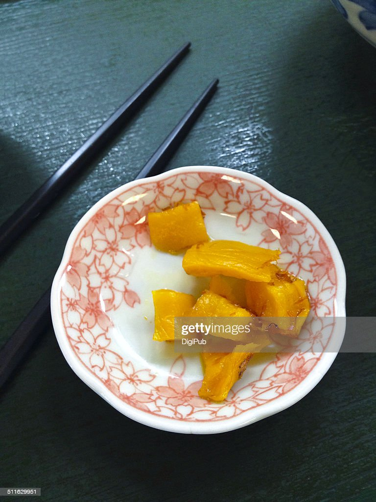 Takuan flavored with katsuoboshi served in saucer : Stock Photo