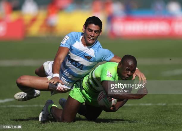 Takudzwa Kumadiro of Zimbabwe is tackled by Santigo Alvarez Fourcade of Argentina during the match between Argentina and Zimbabwe during Day Two of...