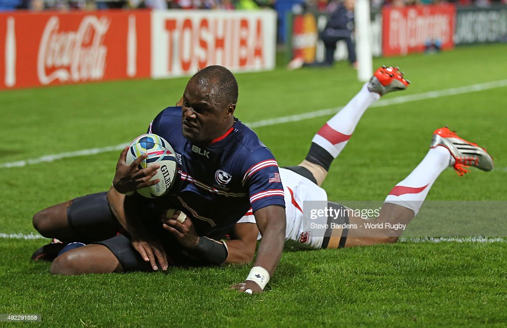 Takudzwa Ngwenya of the United States scores their first try under pressure from Kotaro Matsushima of Japan during the 2015 Rugby World Cup Pool B match between USA and Japan at Kingsholm Stadium on October 11, 2015 in Gloucester, United Kingdom.