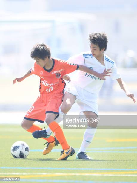 Takuhiro Nakai of Real Madrid Cadete B and Naoki Hotta of Omiya Ardija compete for the ball during the U-15 Kirin Lemon Cup match between Real Madrid...