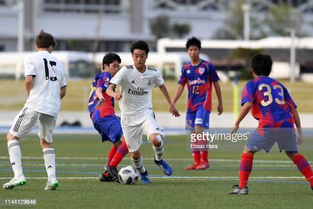 Takuhiro Nakai of Real Madrid controls the ball under pressure of FC Tokyo defenders during the U16 Kirin Lemon Cup final between Real Madrid and FC...