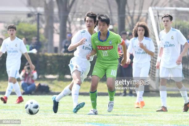 "Takuhiro Nakai ""Pipi"" of Real Madrid Cadete B and Shun Takeda of Shonan Bellmare U-15 compete for the ball during the U-15 Kirin Lemon Cup match..."