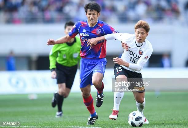 Takuji Yonemoto of FC Tokyo and Kazuki Nagasawa of Urawa Red Diamonds compete for the ball during the JLeague J1 match between FC Tokyo and Urawa Red...