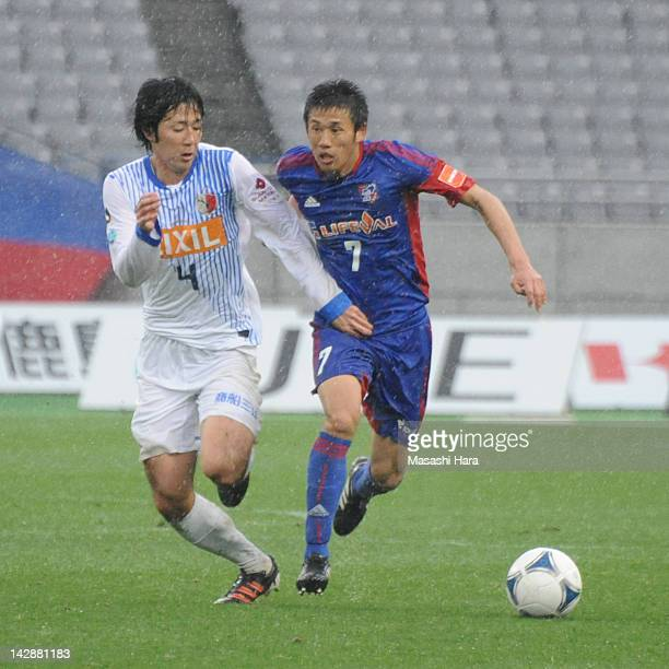 Takuji Yonemoto of FC Tokyo and Kazuya Yamamura of Kashima Antlers compete for the ball during the J.League match between FC Tokyo and Kashima...