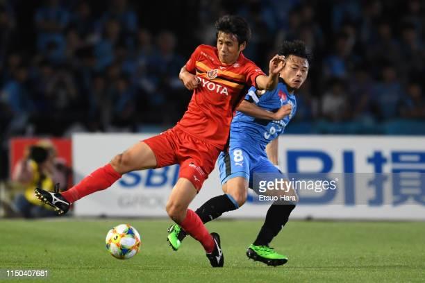 Takuji Yonemoto of Nagoya Grampus and Hiroyuki Abe of Kawasaki Frontale compete for the ball during the JLeague J1 match between Kawasaki Frontale...