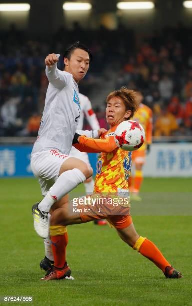 Takuma Arano of Consadole Sapporo and Shota Kaneko of Shimizu SPulse compete for the ball during the JLeague J1 match between Shimizu SPulse and...