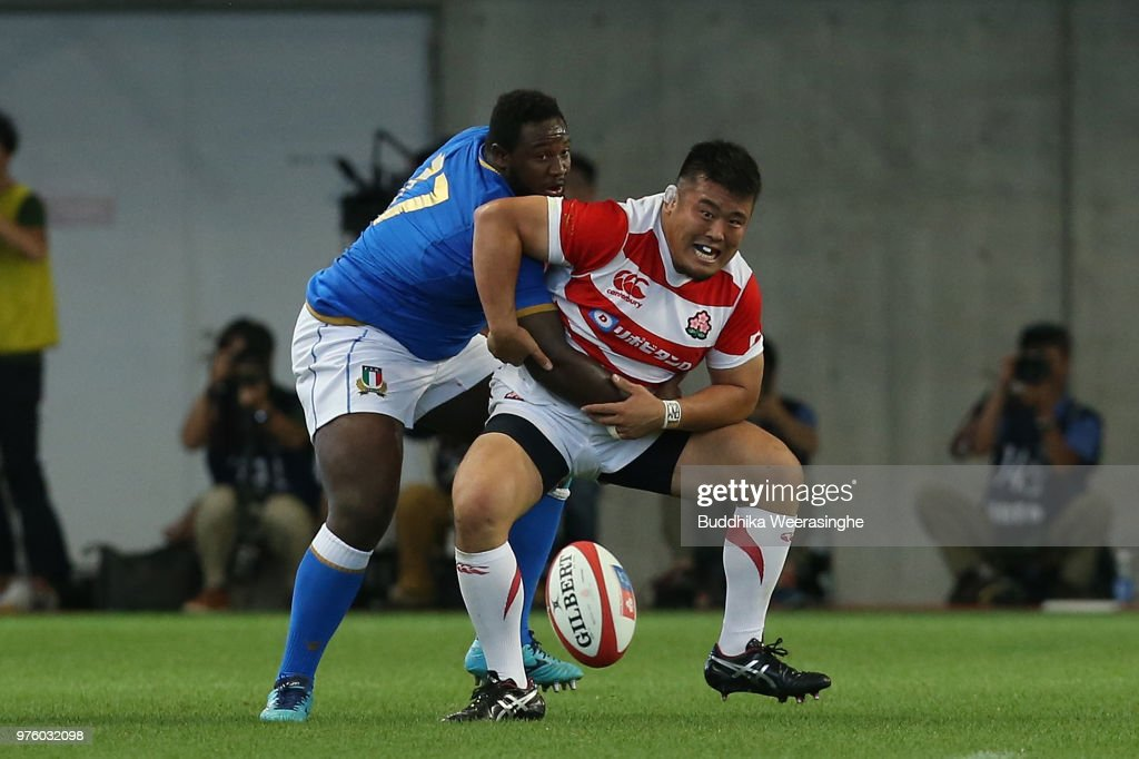 Takuma Asahara of Japan and Cherif Traore of Italy compete for the ball during the rugby international match between Japan and Italy at Noevir Stadium Kobe on June 16, 2018 in Kobe, Hyogo, Japan.