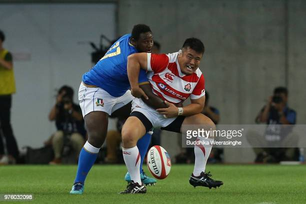 Takuma Asahara of Japan and Cherif Traore of Italy compete for the ball during the rugby international match between Japan and Italy at Noevir...