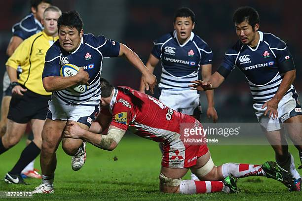 Takuma Asahara of Japan is tackled by Elliott Stooke of Gloucester during the International match between Gloucester and Japan at Kingsholm Stadium...