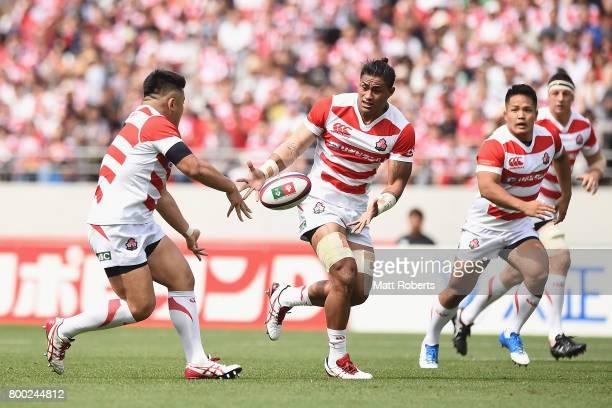 Takuma Asahara of Japan passes the ball to Amanaki Mafi of Japan during the international rugby friendly match between Japan and Ireland at Ajinomoto...