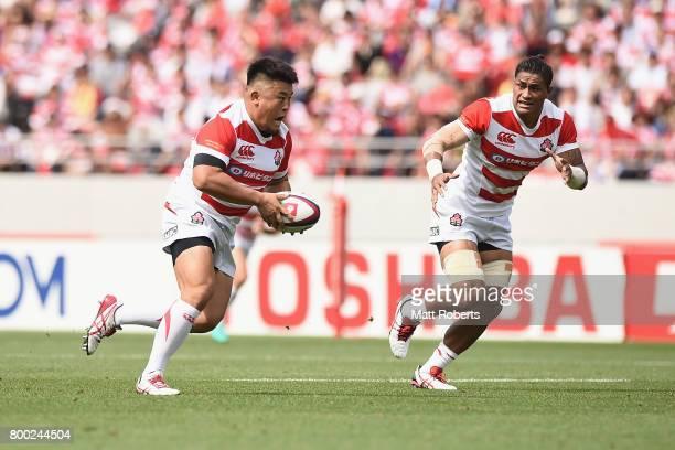 Takuma Asahara of Japan runs with the ball during the international rugby friendly match between Japan and Ireland at Ajinomoto Stadium on June 24,...