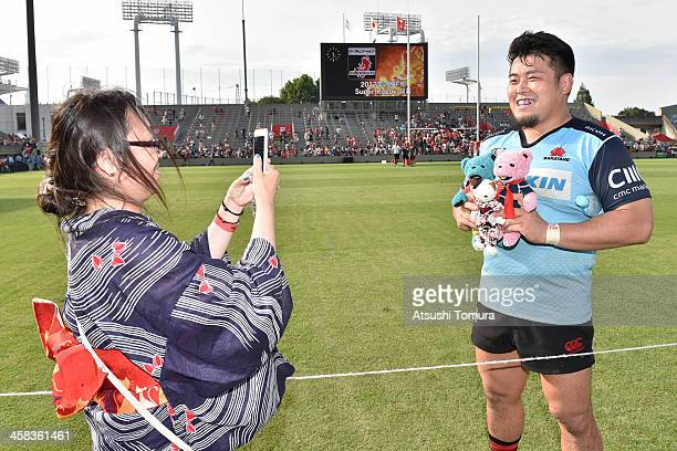 Takuma Asahara of Sunwolves poses for a fan during the round 15 Super Rugby match between the Sunwolves and the Waratahs at Prince Chichibu Stadium...