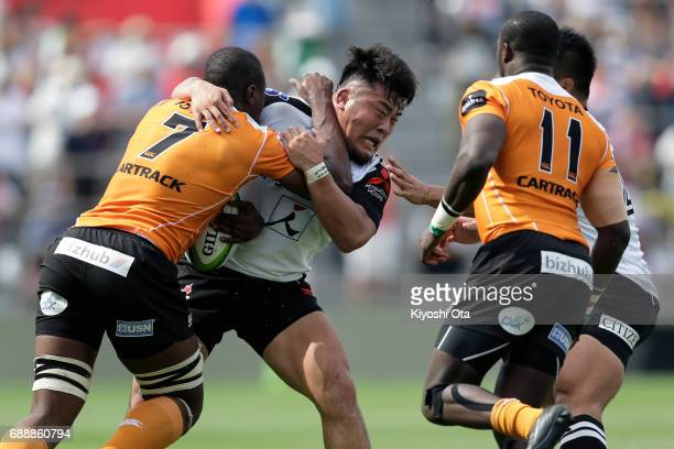 Takuma Asahara of the Sunwolves in action against Oupa Mohoje of the Cheetahs during the Super Rugby Rd 14 match between Sunwolves and Cheetahs at...