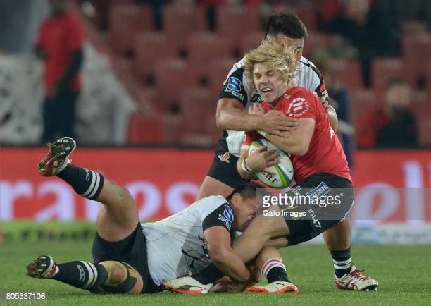 Takuma Asahara of the Sunwolves tackling Faf de Klerk of the Lions during the Super Rugby match between Emirates Lions and Sunwolves at Emirates...