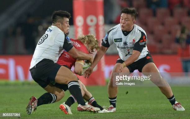Takuma Asahara of the Sunwolves takling Faf de Klerk of the Lions during the Super Rugby match between Emirates Lions and Sunwolves at Emirates...