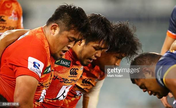 Takuma Asahara, Shota Horie and Keita Inagaki of the Sunwolves pack a scrum during the round 14 Super Rugby match between the Brumbies and the...