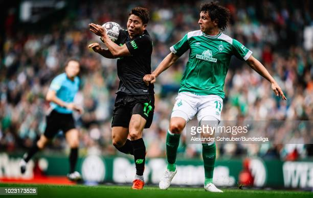 Takuma Asano of Hannover 96h in action against Milos Veljkovic of Werder Bremen during the Bundesliga match between SV Werder Bremen and Hannover 96...