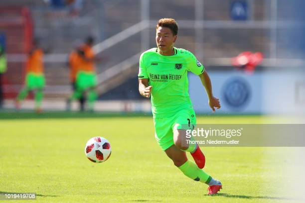 Takuma Asano of Hannover in action with the ball during the DFB Cup first round match between Karslruher SC and Hannover 96 at Wildparkstadion on...