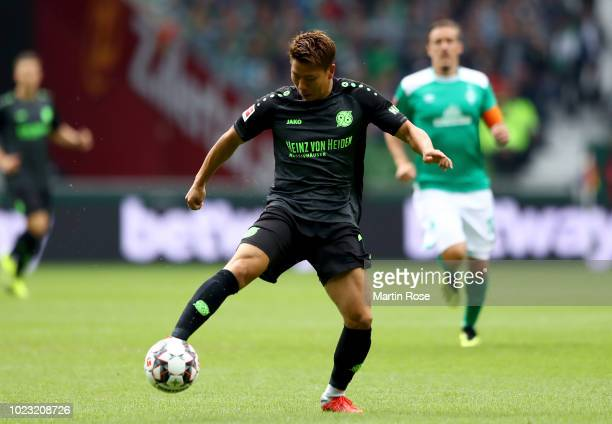 Takuma Asano of Hannover runs with the ball during the Bundesliga match between SV Werder Bremen and Hannover 96 at Weserstadion on August 25 2018 in...