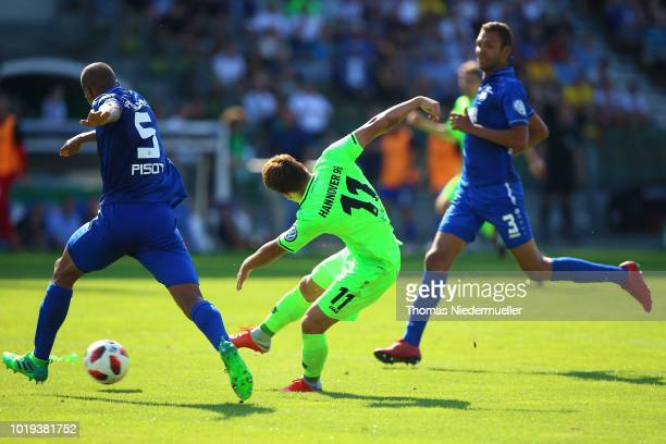 Takuma Asano of Hannover scores during the DFB Cup first round match between Karslruher SC and Hannover 96 at Wildparkstadion on August 19 2018 in...