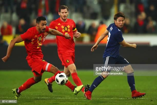 Takuma Asano of Japan battles for the ball with Nacer Chadli and Jan Vertonghen of Belgium during the international friendly match between Belgium...