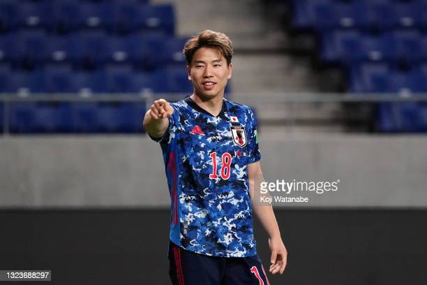 Takuma Asano of Japan celebrates scoring his side's fifth goal during the FIFA World Cup Asian Qualifier second round Group F match between Japan and...