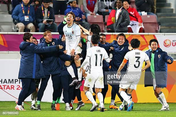 Takuma Asano of Japan celebrates scoring his team's third goal with his team mates during the AFC U23 Championship final match between South Korea...
