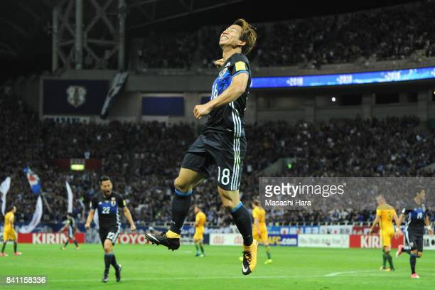 Takuma Asano of Japan celebrates scoring the opening goal during the FIFA World Cup Qualifier match between Japan and Australia at Saitama Stadium on...