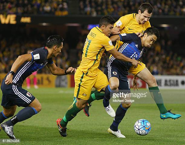 Takuma Asano of Japan compete for the ball against Massimo Luongo of the Socceroos during the 2018 FIFA World Cup Qualifier match between the...