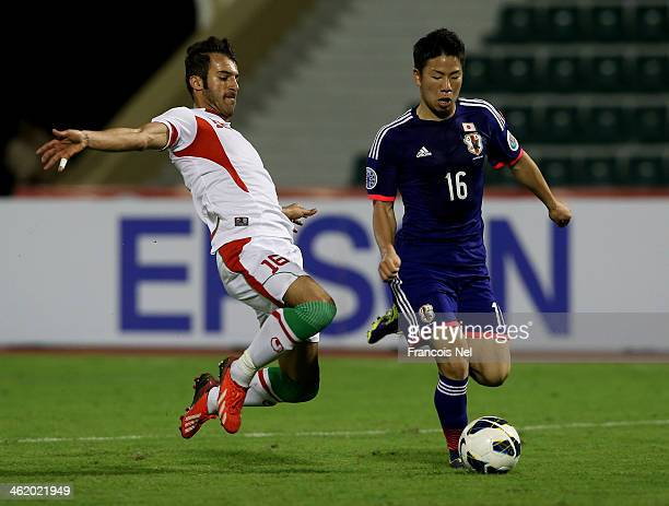 Takuma Asano of Japan competes for the ball with Fardin Abedini of Iran during the AFC U22 Championship Group C match between Japan and Iran at Royal...