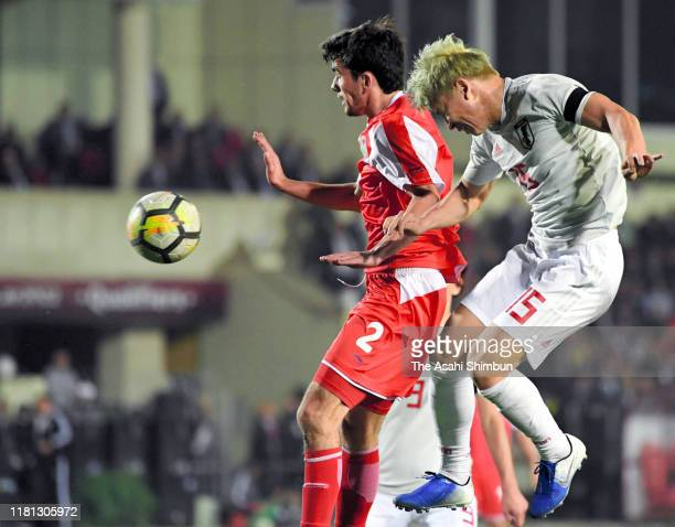 Takuma Asano of Japan heads to score his side's third goal during the FIFA World Cup Asian Qualifier second round Group F match between Tajikistan...