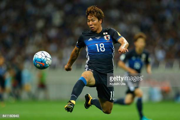Takuma Asano of Japan in action during the FIFA World Cup Qualifier match between Japan and Australia at Saitama Stadium on August 31 2017 in Saitama...
