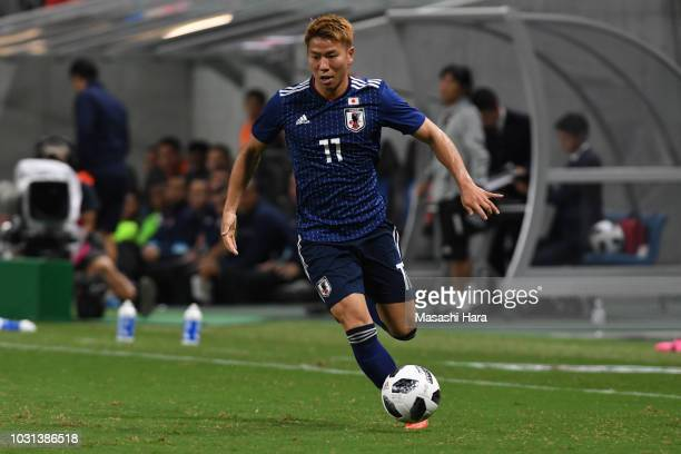 Takuma Asano of Japan in action during the international friendly match between Japan and Costa Rica at Suita City Football Stadium on September 11...