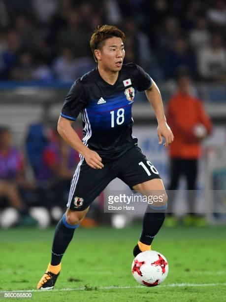 Takuma Asano of Japan in action during the international friendly match between Japan and Haiti at Nissan Stadium on October 10 2017 in Yokohama...