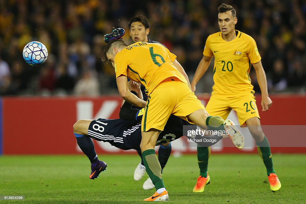 Takuma Asano of Japan kicks Matthew Spiranovic of the Socceroos in the head after an attempt for goal during the 2018 FIFA World Cup Qualifier match between the Australian Socceroos and Japan at Etihad Stadium on October 11, 2016 in Melbourne, Australia.